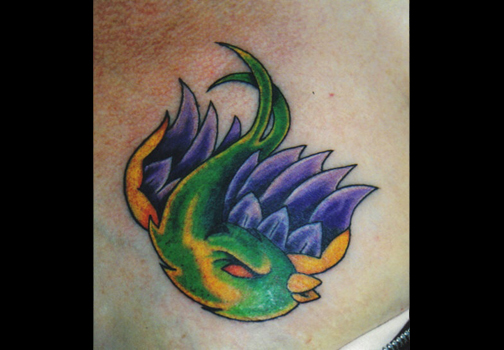 surface piercings � bird tattoo close up