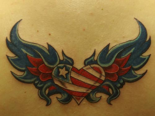 Tattoo of a Corazon with Wings