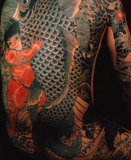 Japanese tattoos usually have koi fish and lots